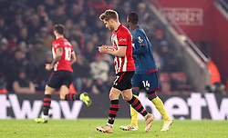 Southampton's Stuart Armstrong reads a note that was handed to him by substitute Charlie Austin during the Premier League match at St Mary's, Southampton.