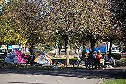 © Licensed to London News Pictures . 24/10/2018. Leeds , UK . People sit amongst tents , pitched in Penny Pocket Park , in Leeds City Centre . At least six people sleeping rough have died in the Metropolitan Borough of the City of Leeds since March 2017 and West Yorkshire Police say they responded to 66 reported cases of people suffering the effects of Spice in July 2018 , a large increase on previous months . Photo credit : Joel Goodman/LNP