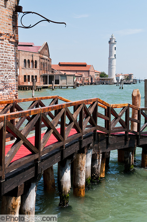 Murano Faro (lighthouse) was built in 1934 from Istrian marble. Known for glass making and lampworking (modern torchworking) since 1291 AD, Murano is a series of islands linked by bridges in the Venetian Lagoon, northern Italy, Europe. Venetian glass is world-renowned as colorful, elaborate, and skillfully made. Once an independent comune, Murano is now a frazione of the comune of Venice. Venice and the Venetian Lagoons are on the prestigious UNESCO World Heritage List.
