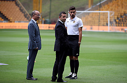 Wolverhampton Wanderers Managing Director Laurie Dalrymple (centre) inspects the pitch with Club Owner and International Chairman of Fosun Mr. Guo Guangchang with Ruben Neves before the game