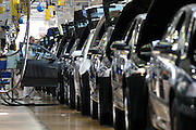 Mlada Boleslav/Tschechische Republik, Tschechien, CZE, 16.03.07: Mitarbeiter am Fertigungsband mit einer Skoda Octavia Karosserie in der Skoda Autofabrik in Mlada Boleslav. Der tschechische Autohersteller Skoda ist ein Tochterunternehmen der Volkswagen Gruppe.<br /> <br /> Mlada Boleslav/Czech Republic, CZE, 16.03.07: Worker at the Skoda factory inspect Octavia vehicle body-frame on the assembly line at Skoda car factory in Mlada Boleslav. Czech car producer Skoda Auto is subsidiary of the German Volkswagen Group (VAG).