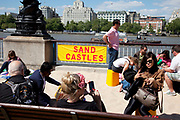 Spring community activities on The Southbank, London. British seaside in central London, on a 70-metre beach that appears on Queen's Walk for the duration of the Festival of Britain celebrations.