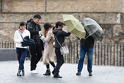 © Licensed to London News Pictures. 08/02/2019. London, UK.  A group of tourists struggle to control their umbrellas during wet and windy weather near the Tower of London. Storm Erik is the first named storm of 2019 with gale force winds and wet weather affecting most of the UK today. Photo credit: Vickie Flores/LNP