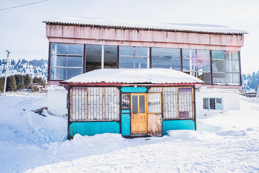 Empty bakery stands behind a market, Jyrgalan, Kyrgyzstan.