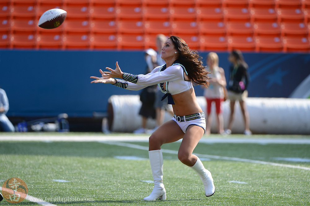 January 26, 2013; Honolulu, HI, USA; Seattle Seahawks cheerleader Heidi Isaacson catches a pass during a game between the NFL cheerleaders and the NFL mascots on Ohana Day at the 2013 Pro Bowl.