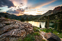 The first hour of sunlight each day can bring a lot with it. A brilliant sunrise over Cecret Lake in the mountains of Salt Lake City is just one of many things.