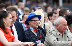 A racegoer looks on during City Day of the 2018 Boodles May Festival at Chester Racecourse.