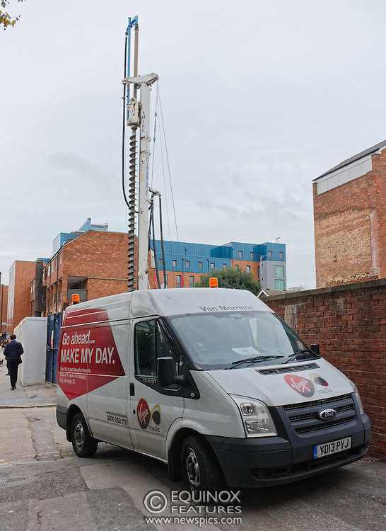 London, United Kingdom - 10 October 2015<br /> Huge drill cuts Virgin fiber cable. Thousand customers without weekend TV and internet. Severed fiber optic cables have caused up to a thousand customers of Virgin Media in Shoreditch and Hackney in London to be left without broadband internet and cable television this weekend. Engineers believe the total loss of service, which continues to be down this Saturday evening, is unlikely to be fixed until Sunday lunchtime at the earliest. The damage to a primary cable carrying 96 fiber optic cables including some belonging to the EE mobile network was caused by a huge drilling rig on a nearby construction site for a block of flats being built by Formation Construction Ltd. An engineer working on the drilling site claimed they had not 'drilled through the cable'. 'We damaged the cable' he said. He then demanded we delete images of the offending drilling rig. Technicians working on behalf of Virgin Media were working hard to replace the damaged cables. Virgin Media press office did not respond to repeated requests to speak with them for comment today.<br /> (photo by: EQUINOXFEATURES.COM)<br /> <br /> Picture Data:<br /> Photographer: Equinox Features<br /> Copyright: ©2015 Equinox Licensing Ltd. +448700 780000<br /> Contact: Equinox Features<br /> Date Taken: 20151010<br /> Time Taken: 17573705<br /> www.newspics.com