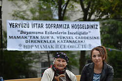 June 17, 2017 - Ankara, Turkey - Two women wait at the park before the pro-Kurdish opposition Peoples' Democratic Party's (HDP) iftar dinner meeting in order to protest against the destruction in Diyarbakir's historic Sur district in the holy month of Ramadan in Ankara, Turkey on June 17, 2017. (Credit Image: © Altan Gocher/NurPhoto via ZUMA Press)