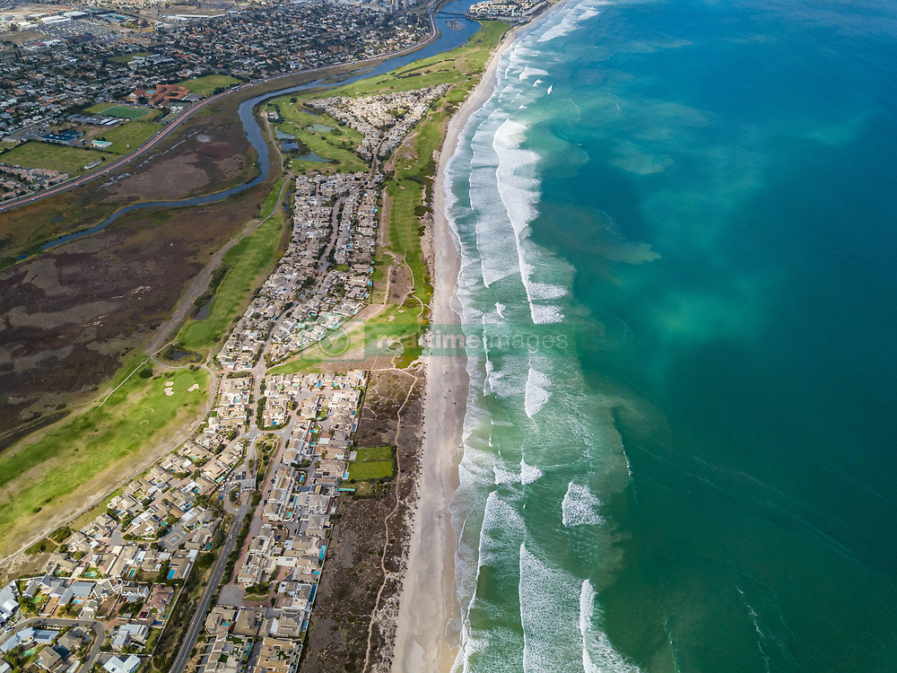 April 25, 2018 - Cape Town, Western Cape, South Africa - Aerial view of Sunset Beach and residential area, Cape Town, South Africa. (Credit Image: © Amazing Aerial via ZUMA Wire)
