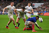Rugby Union - 2020 Guinness Six Nations Championship - France vs. England<br /> <br /> England's George Furbank battles for possession with Frances's Virimi Vakatawa, at The Stade de France, Paris.<br /> <br /> COLORSPORT/ASHLEY WESTERN