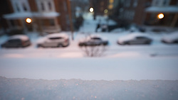 Layer of ice and sleet forms on a second floor windowsill in West Mt Airy, on Tuesday morning as the region is hit by snowstorm Stella. (Bastiaan Slabbers for NewsWorks)
