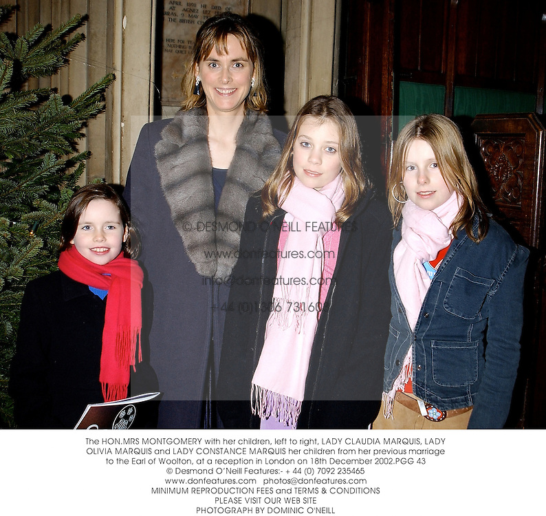 The HON.MRS MONTGOMERY with her children, left to right, LADY CLAUDIA MARQUIS, LADY OLIVIA MARQUIS and LADY CONSTANCE MARQUIS her children from her previous marriage to the Earl of Woolton, at a reception in London on 18th December 2002.PGG 43
