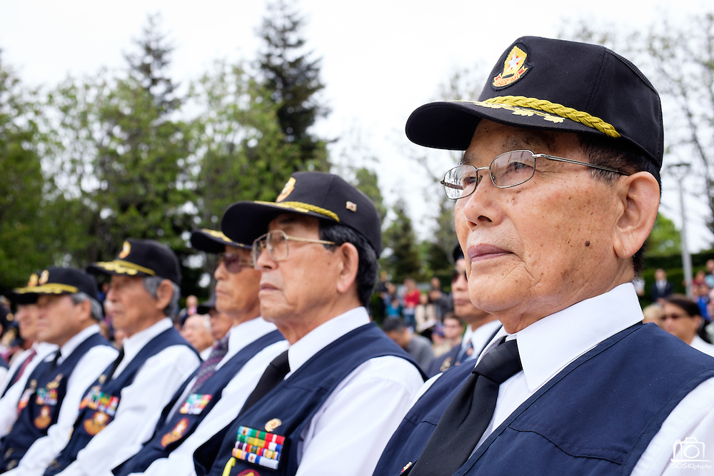 Members of the Korean War Veterans Association of Northern California listen to Mayor Jose Esteves' presentation during the Memorial Day Ceremony at City Hall in Milpitas, California, on May 25, 2015. (Stan Olszewski/SOSKIphoto)