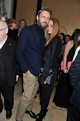 STELLA McCARTNEY and ALASDHAIR WILLIS at a party to celebrate the switching on of the Christmas Lights at the Stella McCartney store, Bruton Street, London on 29th November 2011.
