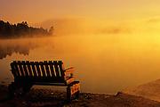 Bench in morning fog alongside Tilton Lake <br /> Sudbury<br /> Ontario<br /> Canada