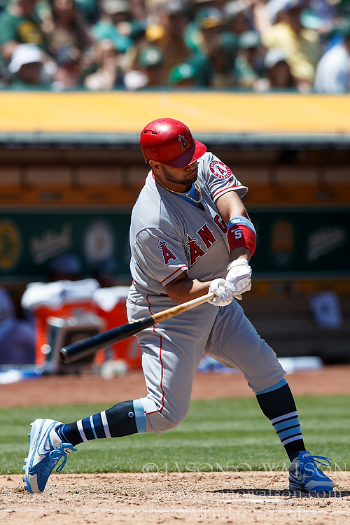 OAKLAND, CA - JUNE 17: Albert Pujols #5 of the Los Angeles Angels of Anaheim hits a home run against the Oakland Athletics during the sixth inning at the Oakland Coliseum on June 17, 2018 in Oakland, California. The Oakland Athletics defeated the Los Angeles Angels of Anaheim 6-5 in 11 innings. (Photo by Jason O. Watson/Getty Images) *** Local Caption *** Albert Pujols