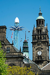 "The 64 metre high clock-tower of Sheffields old town hall  is surmounted by a statue of Vulcan to the left is the tower of the ""Starflyer"" the Uk's tallest city center attraction at 70 meters.<br />  05 June 2016<br />  Copyright Paul David Drabble<br />  www.pauldaviddrabble.photoshelter.com"