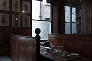 Dark wooden pannelling at the traditional Simpsons Tavern on the 24th September in East London in the United Kingdom. The Simpsons Tavern is a traditional chop house dating back to 1757. A chop house is a restaurant that specialises in steaks and chops.