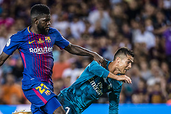 August 13, 2017 - Barcelona, Catalonia, Spain - Real Madrid forward RONALDO flies onto the ground in the penalty area followed by FC Barcelona defender UMTITI in a disputed scene during the Spanish Super Cup Final 1st leg between FC Barcelona and Real Madrid at the Camp Nou stadium in Barcelona. (Credit Image: © Matthias Oesterle via ZUMA Wire)