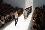 Designer Custo Dalmau of Custo Barcelona waving to the guests at the end of his Spring 2013 show at Fashion Week in New York.