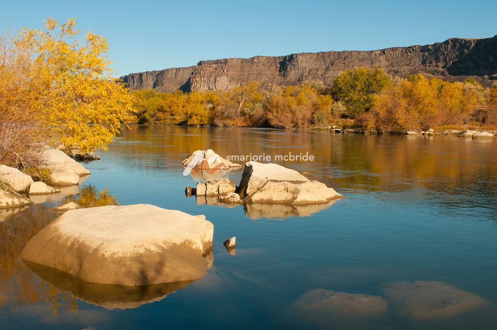 Autumn scenic Snake River at Auger Falls recreation area in Twin Falls, Idaho.