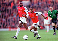 Sylvian Wiltord supported by Patrick Vieira (Arsenal). Arsenal 1: 0 Southampton, F.A.Carling Premiership, 2/12/2000. Credit Colorsport / Stuart MacFarlane
