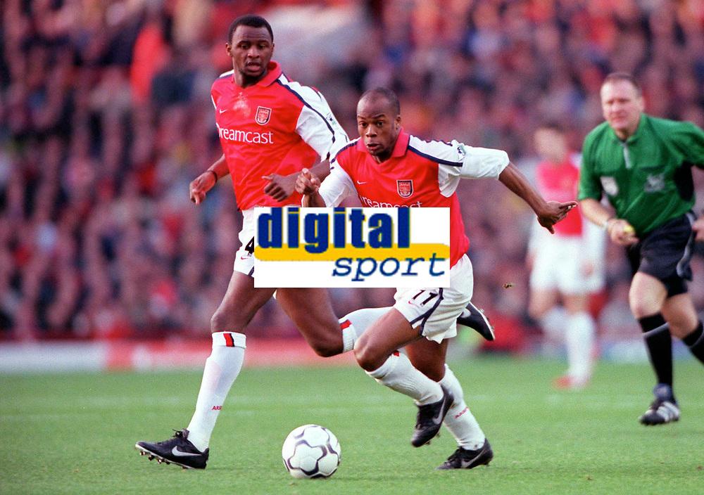 Sylvian Wiltord supported by Patrick Vieira (Arsenal). Arsenal 1: 0 Southampton, F.A.Carling Premiership, 2/12/2000. Credit Colorsport / Stuart MacFarlane