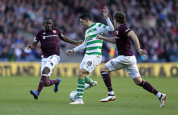 Heart of Midlothian's Arnaud Djoum and Peter Haring (right) battle for the ball with Celtic's Tom Rogic (2R) during the Betfred Cup semi final match at BT Murrayfield Stadium, Edinburgh.