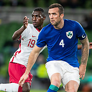 DUBLIN, IRELAND:  October 12:   Almoez Ali #19 of Qatar defended by Shane Duffy#4 of Republic of Ireland during the Republic of Ireland V Qatar International friendly match at Aviva Stadium on October 12th, 2021 in Dublin, Ireland. (Photo by Tim Clayton/Corbis via Getty Images)