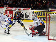 Kloten Flyers forward Victor Stancescu (C) scores the winning goal to the score of 3-2 against ZSC Lions goaltender Ari Sulander (R) during overtime in the ice hockey game five of the Swiss National League A Playoff Quarterfinal between Kloten Flyers and ZSC Lions held at the Kolping Arena in Kloten, Switzerland, Tuesday, March 8, 2011. (Photo by Patrick B. Kraemer / MAGICPBK)