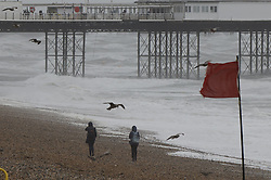 © Licensed to London News Pictures. 30/07/2021. Brighton, UK. People struggle to walk in windy conditions on the sea front at Brighton, East Sussex. Parts of the south are feeling the effects of Storm Evert, the first named storm of summer 2021. Photo credit: Peter Macdiarmid/LNP