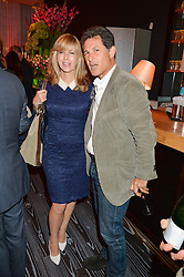 KATE GARRAWAY and JOSHUA BERGER President & Managing Director, Warner Bros. Entertainment UK at a party to celebrate the 21st anniversary of The Roar Group hosted by Jonathan Shalit held at Avenue, 9 St.James's Street, London on 21st September 2015.