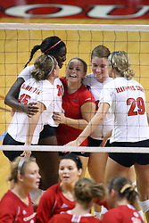15 SEP 2009: Redbirds huddle up to celebrate a point by Hailey Kelley (2nd from left). The Redbirds of Illinois State defeated the Cougars of Southern Illinois Edwardsville in 3 sets during play in the Redbird Classic on Doug Collins Court inside Redbird Arena in Normal Illinois
