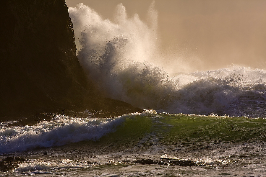 Waves crash against a sea stack at sunset off the coast of Second Beach, Olympic National Park, Washington.