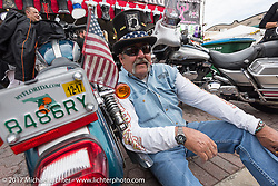 Vietnam Veteran Rich Fitzmaurice takes a break from riding on Main Street during Daytona Beach Bike Week. FL. USA. Sunday March 12, 2017. Photography ©2017 Michael Lichter.