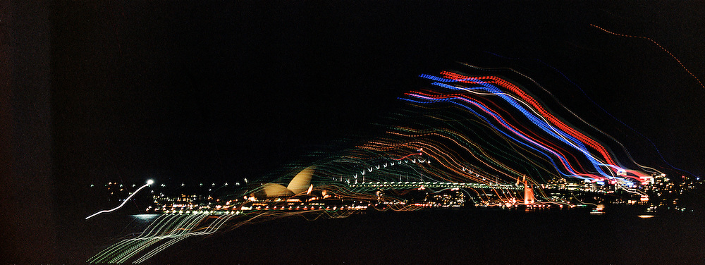 A panoramic view of Sydney at night showing the Sydney Opera House and Harbour Bridge in Sydney, Australia. 23rd July 2011. Photo Tim Clayton
