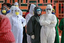 Medical staffs including doctors and nurses wearing protective suits wait to be tested, amid the COVID-19 outbreak, at the Shaheed Suhrawardy Medical College and Hospital in Dhaka, Bangladesh, April 19, 2020. Six doctors of Shaheed Suhrawardy Medical College and Hospital have tested positive with coronavirus infection. The government recently designated Shaheed Suhrawardy Medical College and Hospital as one of the hospitals to treat coronavirus patients. Photo by Suvra Kanti Das/ABACAPRESS.COM