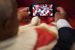 Members of the House of Lords watch coverage of the State Opening of Parliament on their phones whilst they wait for the arrival of Her Majesty The Queen to present the government's Queen's Speech in the House of Lords at the Palace of Westminster in London.