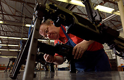 HERSTAL, BELGIUM - APRIL-15-2003 - Machine guns are assembled by hand at the FN Herstal weapons fabrication plant near Liege, Belgium. .(PHOTO © JOCK FISTICK)