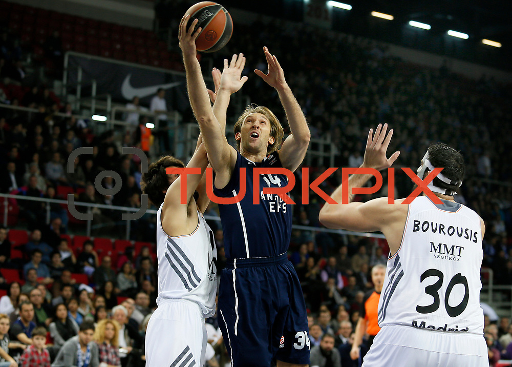 Anadolu Efes's Zoran Planinic (C) during their Turkish Airlines Euroleague Basketball Game 10 match Anadolu Efes between Real Madrid at the Abdi ipekci Arena in Istanbul, Turkey, Thursday, December 19, 2013. Photo by Aykut AKICI/TURKPIX
