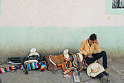 A Mexican cowboy takes a break after arriving to camp at a village stop along the road during the annual Cabalgata de Cristo Rey pilgrimage January 4, 2017 in La Sauceda, Guanajuato, Mexico. Thousands of Mexican cowboys and horse take part in the three-day ride to the mountaintop shrine of Cristo Rey stopping along the way at shrines and churches.