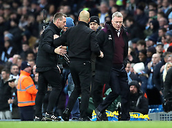 Manchester City manager Pep Guardiola (left) and West Ham United manager David Moyes (right) shake hands after the final whistle during the Premier League match at the Etihad Stadium, Manchester.