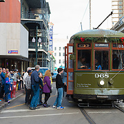 People enter trolley car in New Orleans, LA