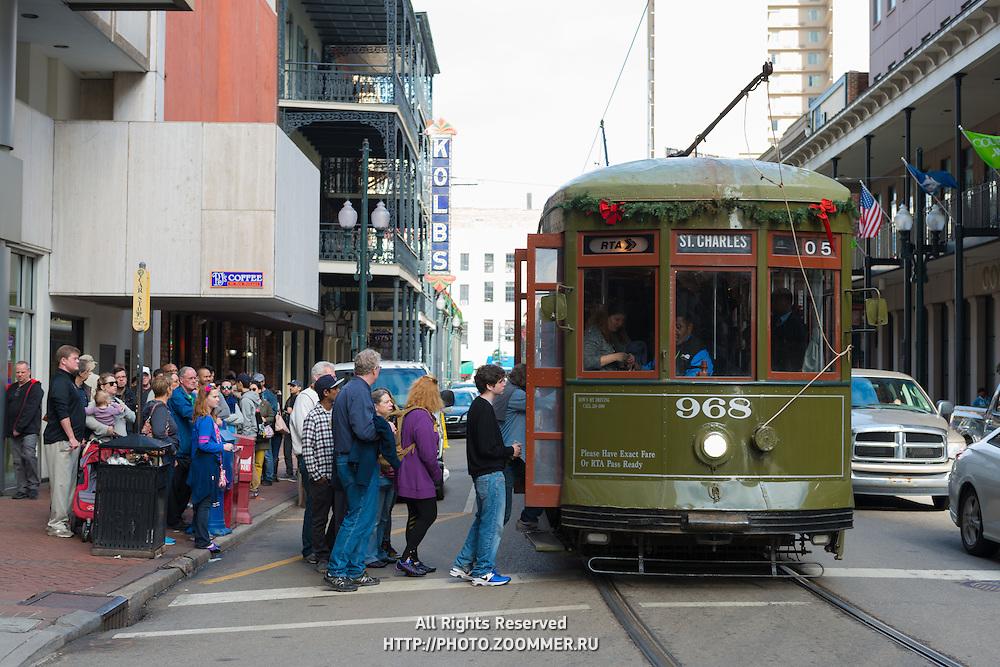 People enter trolley car in New Orleans, LA