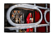 SHOT 2/11/18 10:06:45 AM - A capilla dedicated to Santa Muerte near Lo de Marcos, Mexico. Santa Muerte (Holy Death), is a female deity (or folk saint depending on school of thought) in Mexican folk religion, particularly Folk Catholicism, venerated primarily in Mexico and the Southwestern United States. A personification of death, she is associated with healing, protection, and safe delivery to the afterlife by her devotees. Despite condemnation by the Catholic Church her devotees have grown in numbers lately and many followers of Santa Muerte live on the margins of the law or outside it entirely.  In the Mexican and U.S. press, the Santa Muerte cult is often associated with violence, criminality, and the illegal drug trade. Altars of Santa Muerte temples generally contain one or multiple images of the Lady, generally surrounded by any or all of the following: cigarettes, flowers, fruit, incense, water, alcoholic beverages, coins, candies and candles. Capillas are common along the roads and highways of Mexico which is heavily Catholic and are often dedicated to certain patron saints or to the memory of a loved one that has passed away. Often times they contain prayer candles, pictures, personal artifacts or notes. (Photo by Marc Piscotty / © 2018)