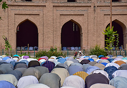 June 15, 2018 - Srinagar, Jammu & Kashmir, India - Kashmiri Muslims pray outside the Jamia Masjid or grand mosque on the last Friday of the holy month of Ramadan..Ramadan is a period of intense prayer, dawn-to-dusk fasting and nightly feasts. (Credit Image: © Abbas Idrees/SOPA Images via ZUMA Wire)
