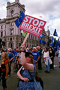 A Pro-EU protester holds up a Stop Brexit sign  on Parliament Square, London