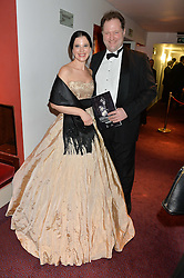 OLGA BALAKLEETS and her husband JULIAN GALLANT at the 10th anniversary Gala of the Russian Ballet Icons at the London Coliseum, St.Martin's Lane, London on 8th March 2015.