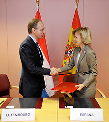 Luc Frieden, Luxembourg's minister of Finance, left, and Elena Salgado, Spain's finance minister, right, sign a taxation agreement between the two countries, at the EU Council headquarters in Brussels, Belgium, on Tuesday, Nov. 10, 2009. (Photo © Jock Fistick)